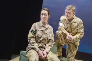 "Left to right, Sarah Finng and Brad Long in the Great Canadian Theatre Company production of ""This is War."" Photograph by: Chris Mikula , The Ottawa Citizen"